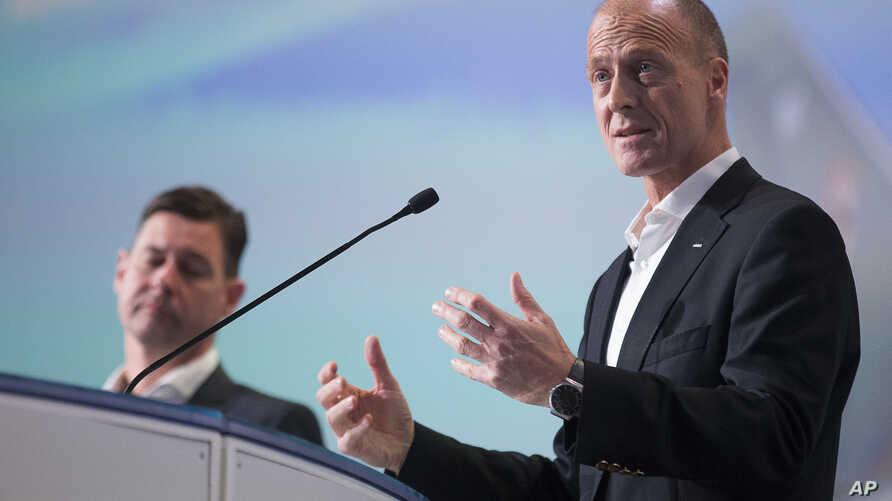 Airbus CEO Tom Enders, right, speaks to journalists while Airbus CFO Harald Wilhelm looks on, during the Airbus Group press conference on the 2017 annual results in Toulouse, France, Feb. 15, 2018.