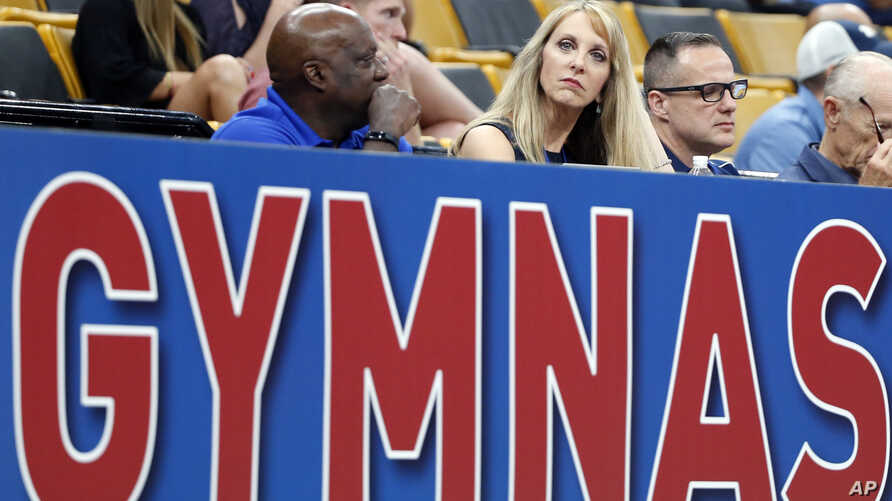 FILE - USA Gymnastics President and CEO Kerry Perry (C) watches the U.S. Gymnastics Championships, in Boston, Aug. 16, 2018.