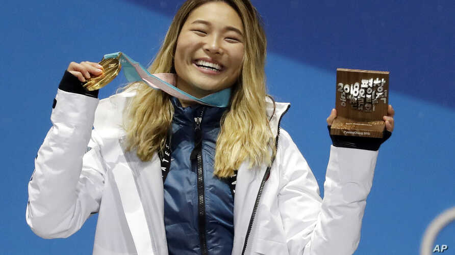 FILE - women's halfpipe gold medalist Chloe Kim, of the United States, poses during the medals ceremony at the 2018 Winter Olympics, in Pyeongchang, South Korea, Feb. 13, 2018.