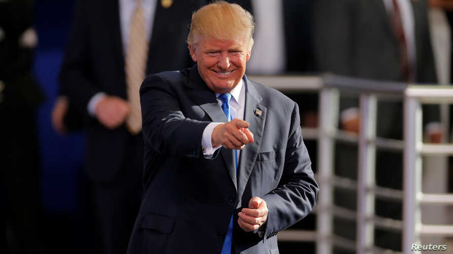 Republican presidential nominee Donald Trump gestures as he arrives for a campaign rally in Raleigh, North Carolina, Nov. 7, 2016.