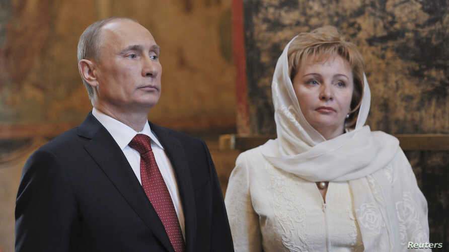 Vladimir Putin (L) is seen with his his then wife Lyudmila at a church service in Moscow, May 7, 2012.