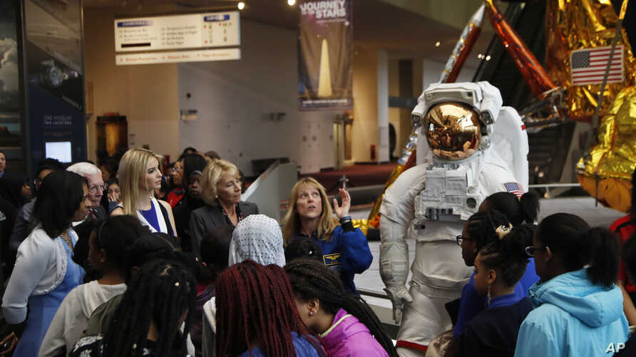 Ivanka Trump, third from left to right, and Education Secretary Betsy DeVos, listen to NASA Astronaut Kay Hire, during their visit to the Smithsonian's National Air and Space Museum in Washington, March 28, 2017, to celebrate Women's History Month.