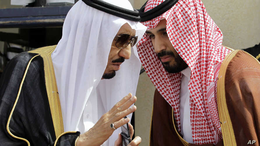 FILE - In this May 14, 2012 file photo, then Crown Prince Salman bin Abdul-Aziz Al Saud, left, speaks with his son Prince Mohammed as they wait for Gulf Arab leaders ahead of the opening of Gulf Cooperation Council, also known as GCC summit, in Riyad