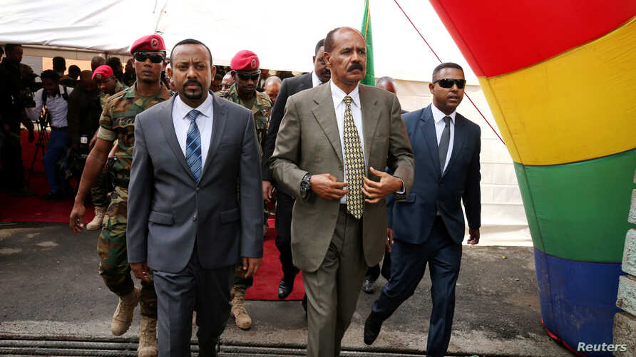 FILE - Eritrea's President Isaias Afwerki and Ethiopia's Prime Minister, Abiy Ahmed arrive for an inauguration ceremony marking the reopening of the Eritrean embassy in Addis Ababa, Ethiopia, July 16, 2018.