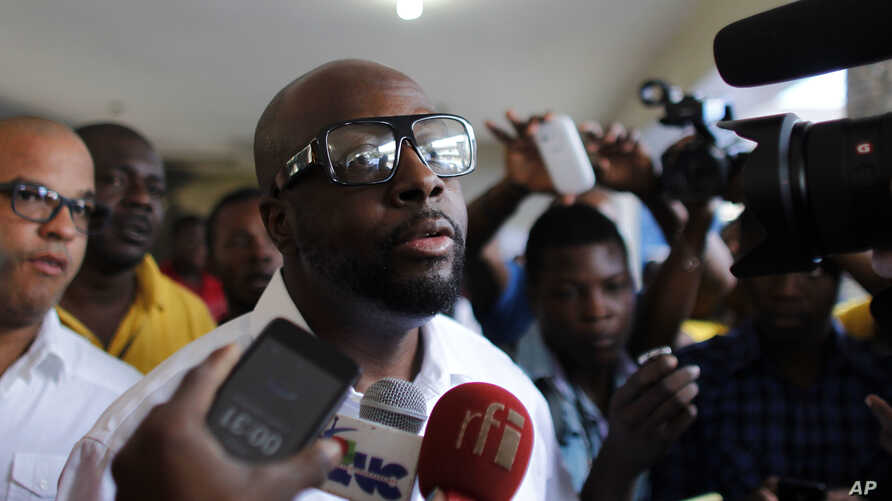 FILE - Haitian-American musician Wyclef Jean talks to the press in the Petion-Ville suburb of Port-au-Prince, Haiti, Nov. 20, 2016.