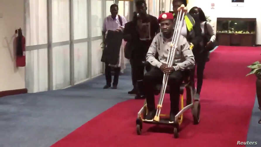 Bobi Wine is seen in a wheelchair just before his departure at Entebbe International Airport, in Entebbe, Uganda, Aug. 31, 2018 in this still image taken from a social media video on September 1, 2018.