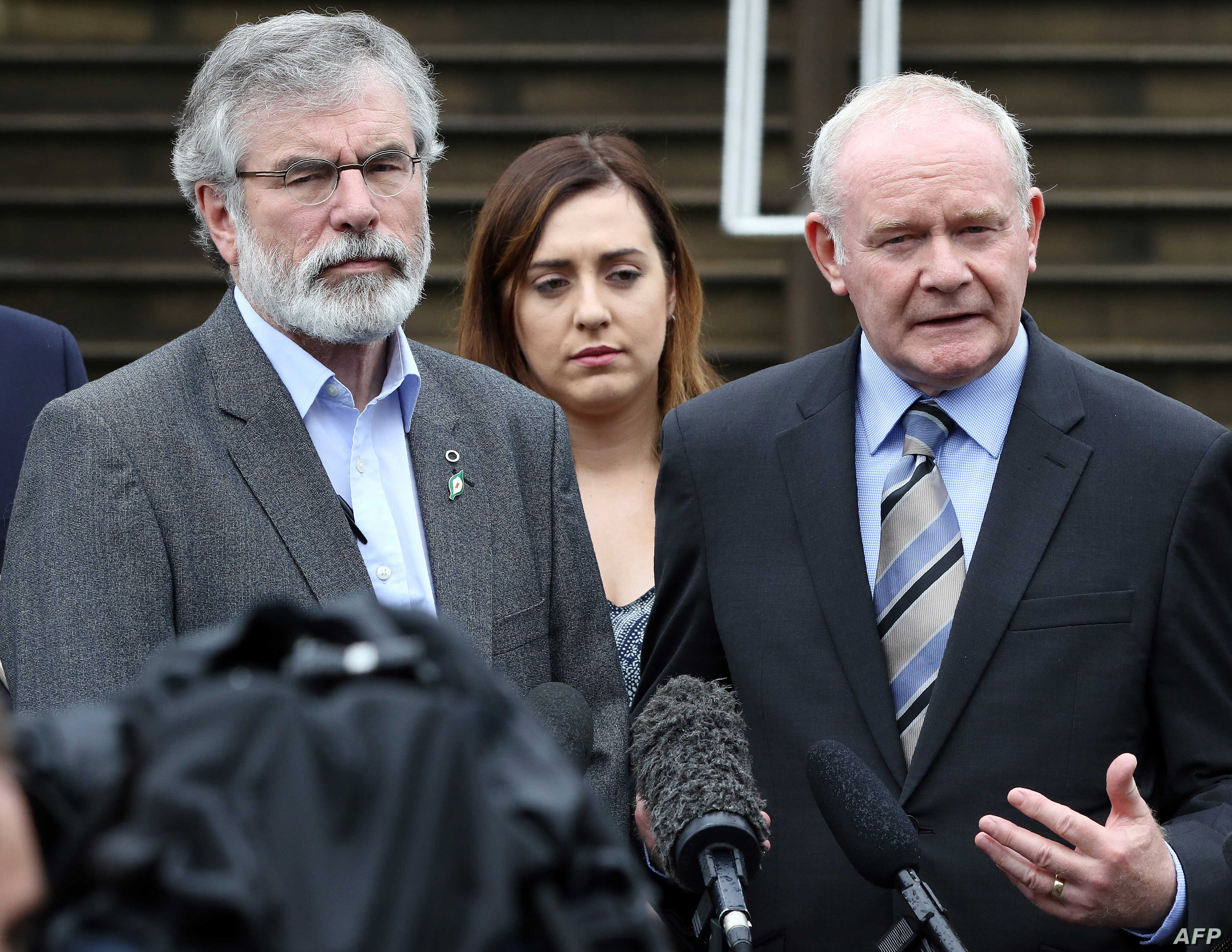 Sinn Fein leader Gerry Adams (L) and Sinn Fein politician and Northern Ireland's Deputy First Minister, Martin Mcguinness (R) speak during a press conference outside Stormont Castle in Belfast, Northern Ireland on June 24, 2016, following the result