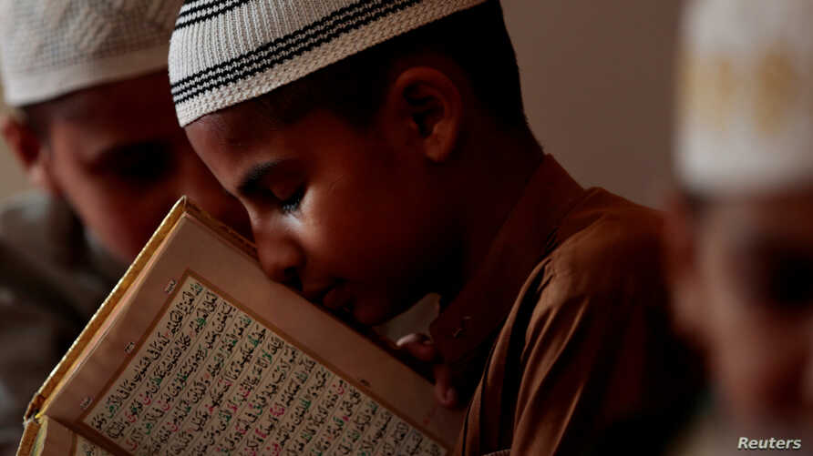 A student memorizes the Koran at a madrassa in Murree, Pakistan Sept. 27, 2017