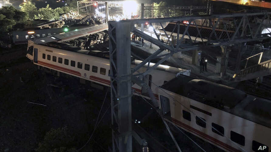 This photo released by Military News Agency shows a general view at the site of a train derailment in Lian in northern Taiwan, Oct. 21 2018.