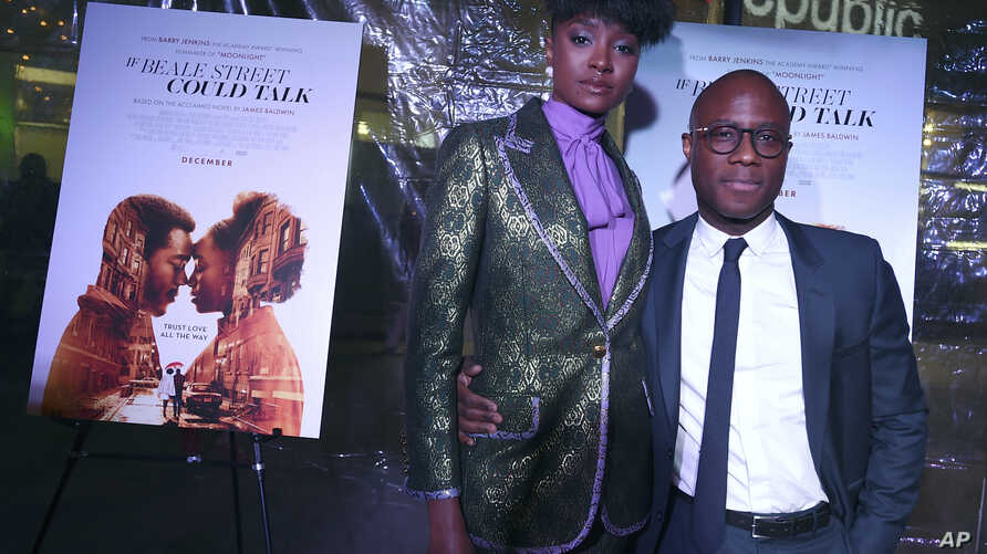 """FILE - KiKi Layne, left, and director Barry Jenkins arrive at a special screening of """"If Beale Street Could Talk"""" at ArcLight Hollywood in Los Angeles, Dec. 4, 2018."""