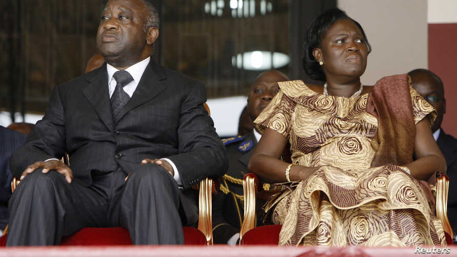 FILE - Ivory Coast President Laurent Gbagbo and his wife Simone Ehivet Gbagbo attend a memorial ceremony at Felix Houphouet Boigny stadium in Abidjan.