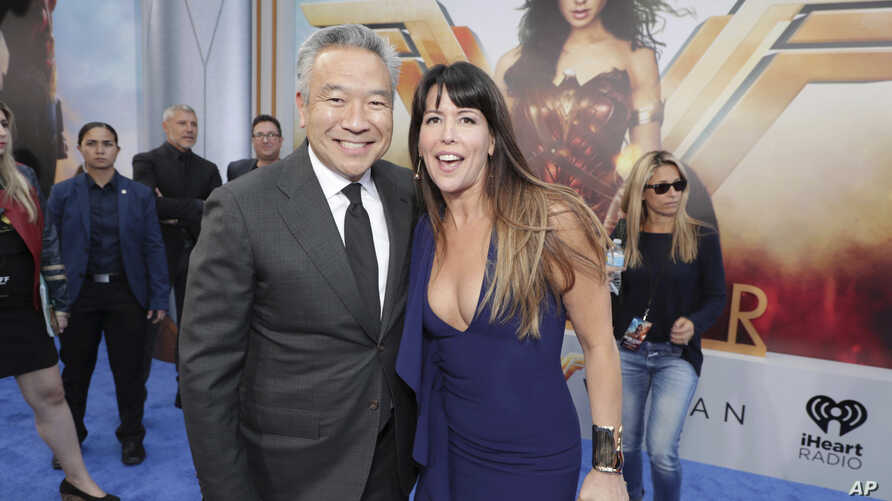 """FILE - Kevin Tsujihara, then-Chairman and CEO of Warner Bros., and Director Patty Jenkins seen at The World Premiere of Warner Bros. Pictures """"Wonder Woman"""" at The Pantages Theatre May 25, 2017, in Los Angeles."""