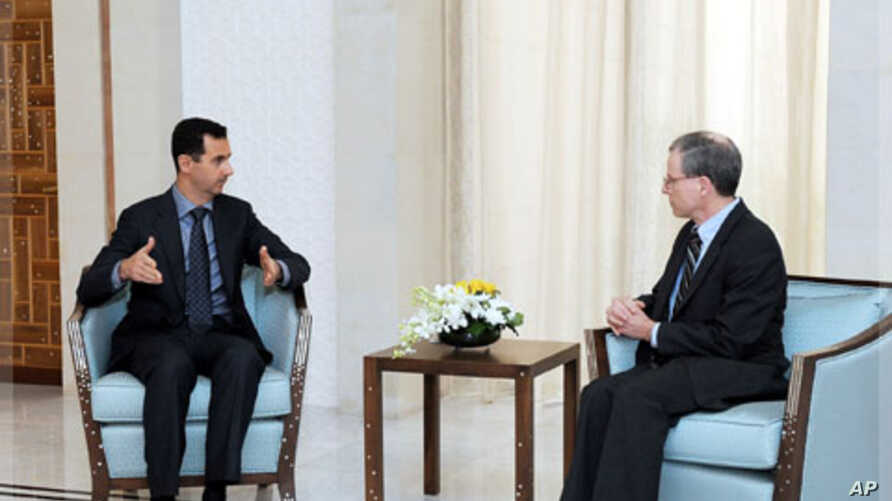 New U.S. ambassador Robert Ford (R) talks with Syria's President Bashar al-Assad after presenting his credentials to Assad, in Damascus January 27, 2011.