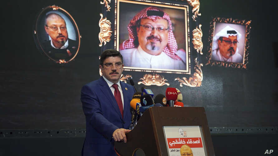 Yasin Aktay, an advisor to Turkey's President Recep Tayyip Erdogan, speaks during an event organized to mark the 40th day of the death of Saudi writer Jamal Khashoggi, in Istanbul, late Sunday, Nov. 11, 2018.