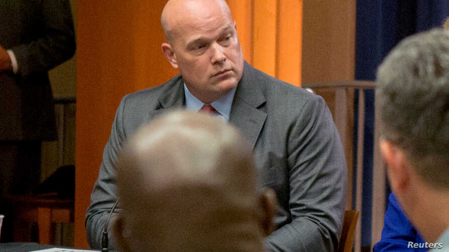 FILE PHOTO:  Matthew Whitaker attends a roundtable discussion with foreign liaison officers at the Justice Department in Washington,  Aug. 29, 2018.