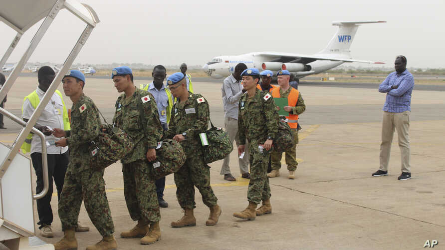 Japan's Ground Self-Defense Force troops board a plane as they start leaving South Sudan, April 17 2017, as part of the process to end their five-year participation in the ongoing U.N. peacekeeping mission.
