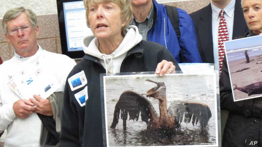 FILE - Scottie Franklin, a diver, speaks at a public hearing in Atlantic City N.J., April 27, 2012, on whether the federal government should allow seismic testing to look for oil and natural gas deposits on the eastern coast of the United States betw