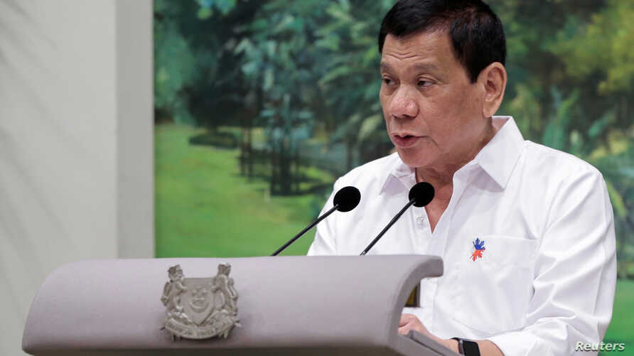 Philippines President Rodrigo Duterte delivers a speech at the start of a state dinner hosted by Singapore's President Tony Tan at the Istana in Singapore, Dec. 15, 2016.