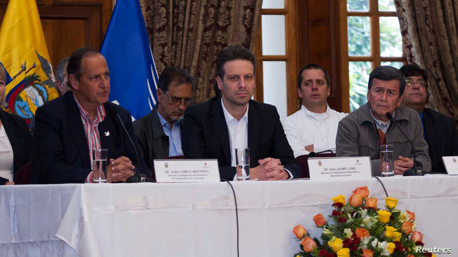 (L-R) Juan Camilo Restrepo Colombia's government representative, Ecuadorean Foreign Minister Guillaume Long and Pablo Beltran representative of the delegation of National Liberation Army (ELN) for formal peace talks with Colombian government, hold a