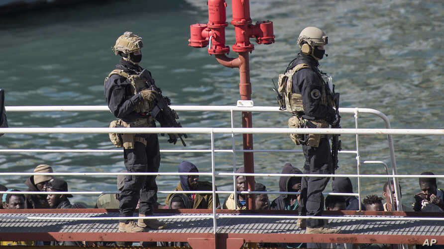 Armed forces stand on board the Turkish oil tanker El Hiblu 1, which was hijacked by migrants, in Valletta, Malta, March 28, 2019. A Maltese special operations team boarded the tanker Thursday and took control of it before escorting it to a Maltese p