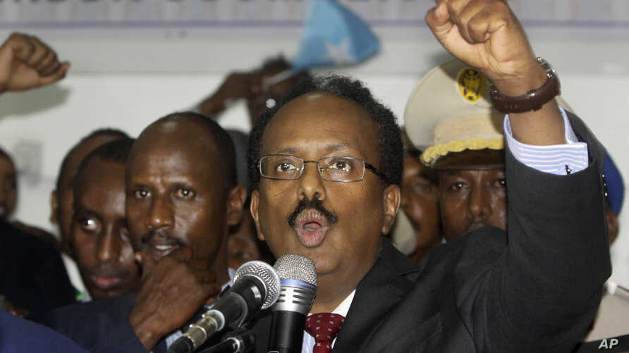New Somali President Mohamed Abdullahi Farmajo celebrates winning the election and taking office in Mogadishu, Somalia Wednesday, Feb. 8, 2017.