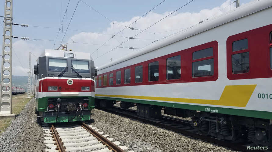 In this photo taken Sept. 24, 2016, locomotives for the new Ethiopia to Djibouti electric railway system queue outside a train station in the outskirts of Addis Ababa.