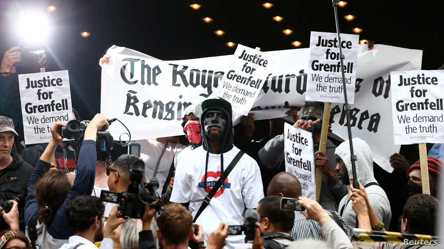 Demonstrators protest against what they see as an inadequate response to last month's Grenfell Tower fire, outside a Kensington and Chelsea Council meeting, at Kensington Town Hall in London, Britain, July 19, 2017.