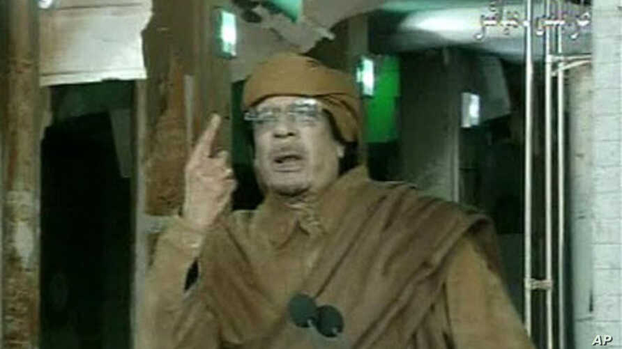 This image broadcast on Libyan state television, February 22, 2011, shows country's leader Moammar Gadhafi reportedly addressing the nation from Tripoli