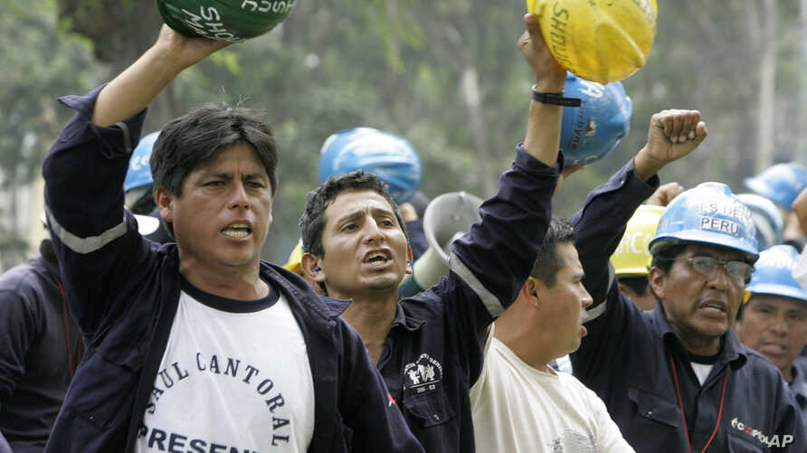 FILE - A group of miners demonstrate against Peru's government at the front of Labor Ministry building in Lima, May 3, 2007. A national strike to back a series of labor-related demands began days later led by Peru's National Federation of Mining, Met