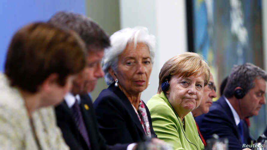 Christine Lagarde, Managing Director of the International Monetary Fund (IMF), and German Chancellor Angela Merkel attend a news conference after a meeting in the chancellery in Berlin, Germany, June 11, 2018.