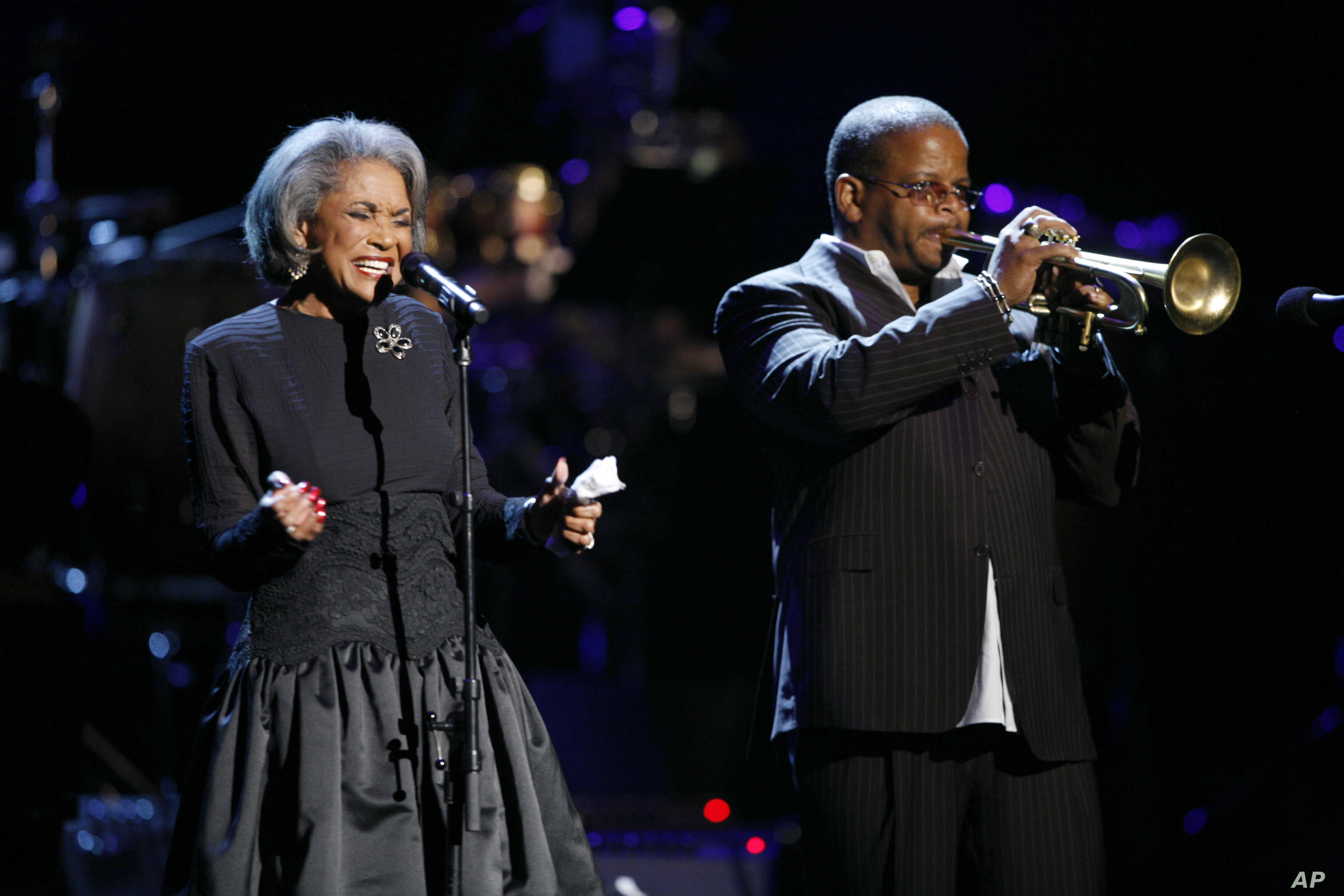 FILE - In this Oct. 28, 2007 file photo, Nancy Wilson, left, and Terence Blanchard, right, perform during an all-star tribute concert for Herbie Hancock, in Los Angeles.
