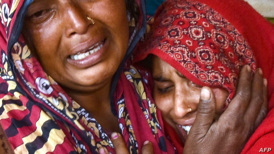 In this photograph taken on Feb. 10, 2019, Indian relatives of victims who died from toxic locally-made alcohol cry at Saharanpur Civil Hospital in Saharanpur in the northern state of Uttar Pradesh.