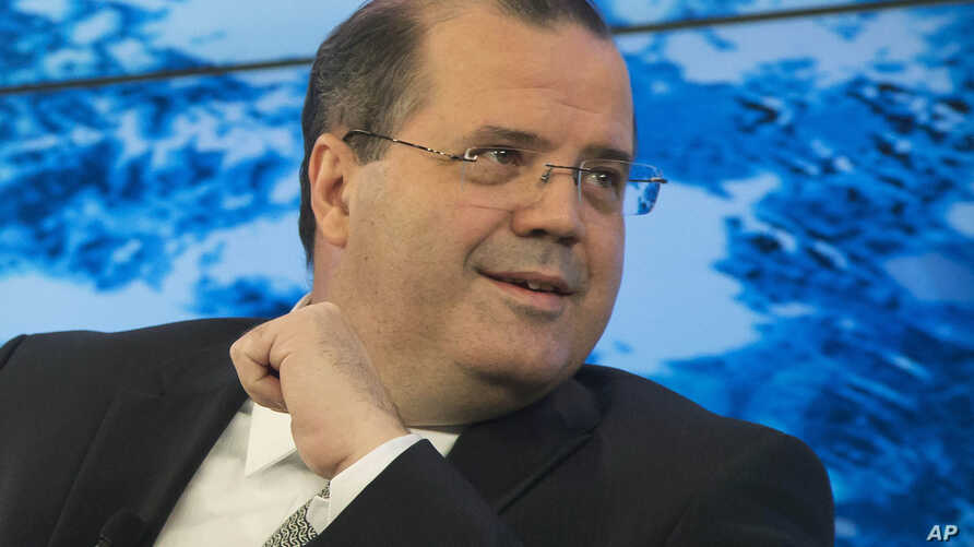 Brazilian central bank President Alexandre Tombini, pictured at the World Economic Forum in Davos, Switzerland, in 2014, has not ruled out selling part of the country's $371 billion foreign reserves to calm the exchange rate market.