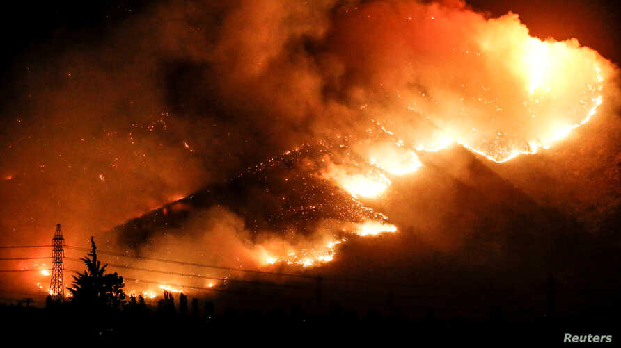 Fire is seen on a hill in Pirque, on the outskirts of Santiago, Chile Jan. 20, 2017.