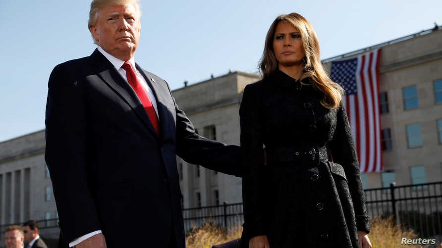 U.S. President Donald Trump and first lady Melania Trump attend the 9/11 observance at the National 9/11 Pentagon Memorial in Arlington, Virginia, Sept.11, 2017.