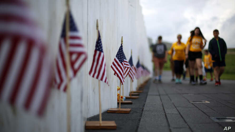 Visitors to the Flight 93 National Memorial pauses at the Wall of Names containing the names of the 40 passengers and crew of United Flight 93 that were killed in this field on Sept. 11, 2001, on Thursday, May 31, 2018. Later this year, the remaining