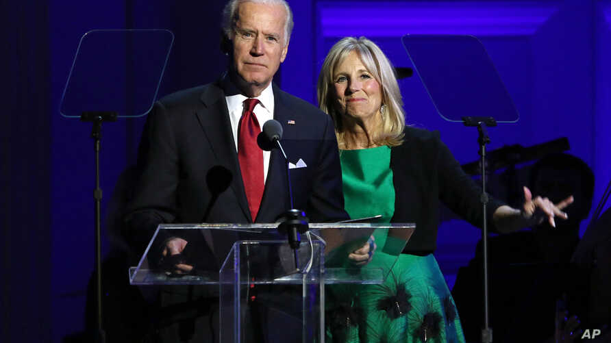 Vice President Joe Biden, left, and Jill Biden speak at 'It Always Seems Impossible Until It Is Done: A Night of Music with ONE and (RED)', in celebration of World AIDS Day, at Carnegie Hall, Dec. 1, 2015, in New York.