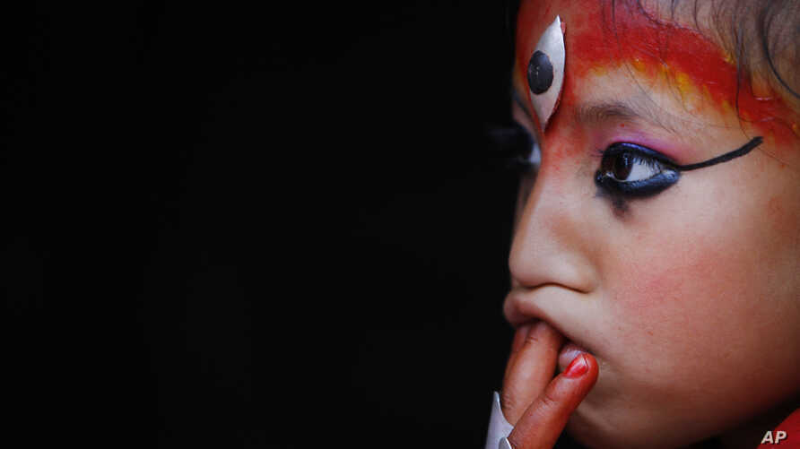 Nepal's Kumari, or living goddess, watches the Rato Machindranath chariot Festival in Lalitpur, Nepal, April 24, 2015.