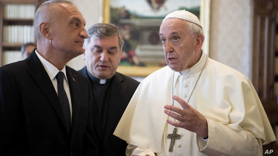 Pope Francis talks with Albania's President, Ilir Meta (L) during a private audience at the Vatican, Sept. 17, 2018.