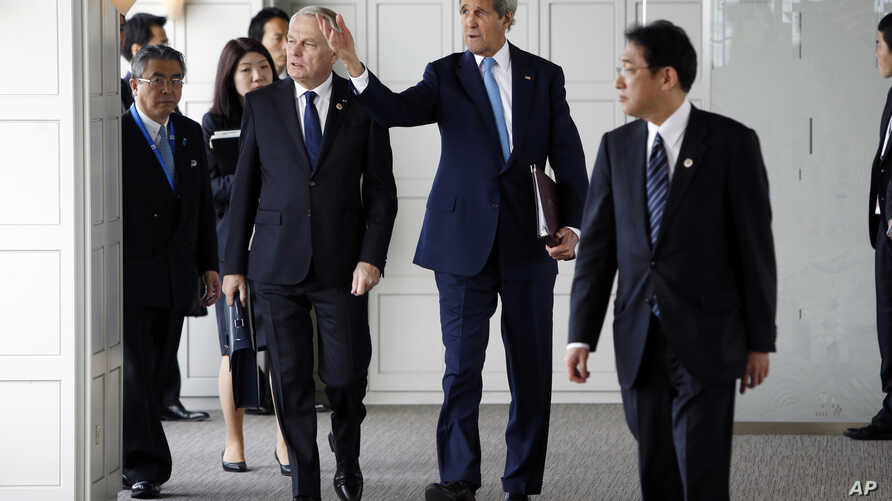 France's Foreign Minister Jean-Marc Ayrault, front left, U.S. Secretary of State John Kerry, center, Japan's Foreign Minister Fumio Kishida, front right, and their fellow G-7 foreign ministers are seen assembling for a working session in Hiroshima, w
