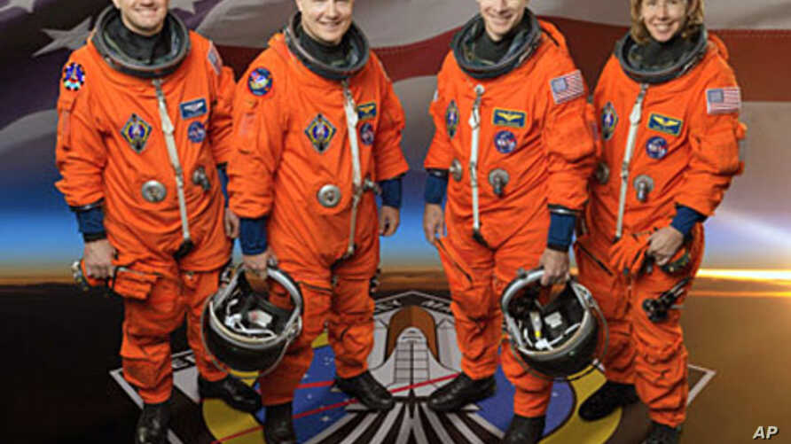 Shuttle Atlantis' final mission will include mission commander Chris Ferguson (CR), pilot Doug Hurley (CL), and mission specialists Rex Walheim and Sandy Magnus