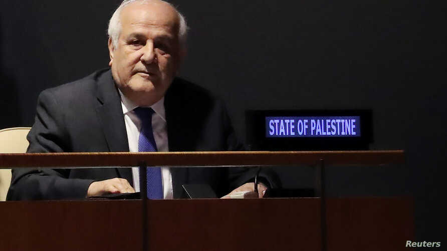 Palestinian Ambassador to the United Nations Riyad Mansour sits while members of the U.N. General Assembly vote on whether to allow the Palestinians to procedurally act like a member state during meetings in 2019, when they will chair the group of 77
