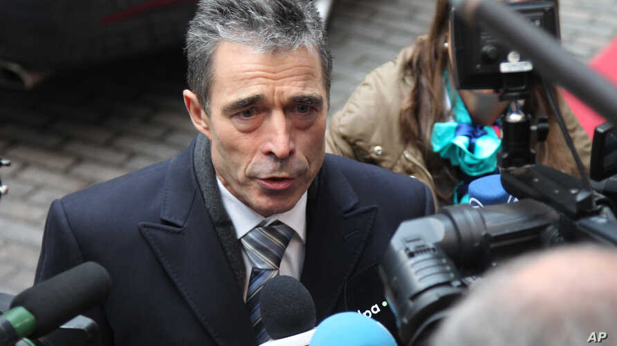 NATO Secretary General Anders Fogh Rasmussen answers questions by journalists, prior to the start of the EU foreign and defense ministers meeting at the European Council building in Brussels, November 19, 2012.