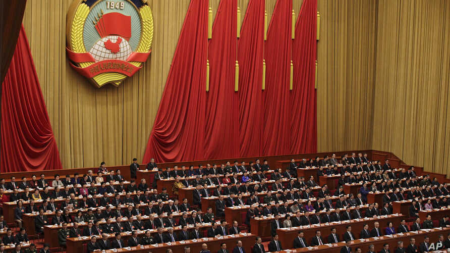 Chinese People's Political Consultative Conference (CPPCC) chairman and Politburo Standing Committee member Wang Yang delivers a closing speech for the Chinese People's Political Consultative Conference (CPPCC) at the Great Hall of the People in Beij
