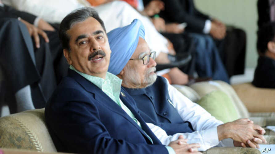 Pakistan's Prime Minister Yusuf Raza Gilani sits with his Indian counterpart Manmohan Singh as they watch the ICC Cricket World Cup semi-final match between India and Pakistan in Mohali, India, March 30, 2011.