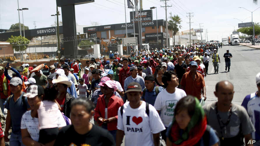 Central American migrants traveling with the annual migrant Stations of the Cross caravan march for migrants' rights and protest the policies of U.S. President Donald Trump, in Hermosillo, Mexico, April 23, 2018.