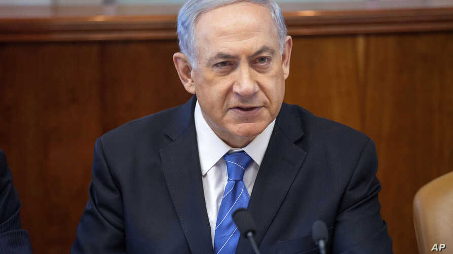 Israel's Prime Minister Benjamin Netanyahu chairs the weekly cabinet meeting in Jerusalem, Aug. 17, 2014.