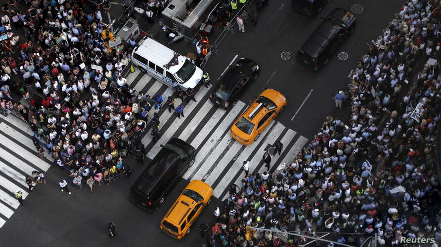 Some of several thousand protestors crowd into 7th Avenue at 42nd street as they demonstrate during a rally apposing the nuclear deal with Iran in Times Square in the Manhattan borough of New York City, July 22, 2015.