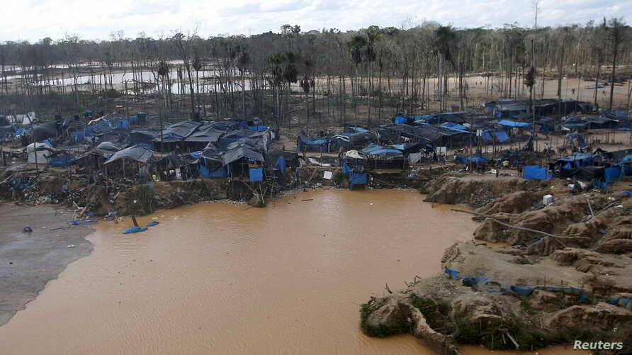 A view of an illegal gold mining camp in a zone known as Mega 14, in the southern Amazon region of Madre de Dios, July 14, 2015.