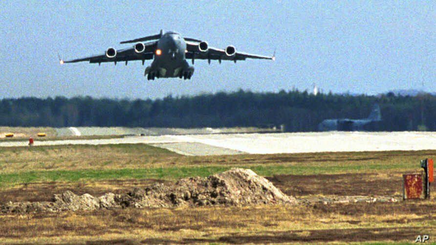 FILE - A US Air Force C17 Globemaster 3 transport plane takes off from Ramstein airbase, with humanitarian aid.